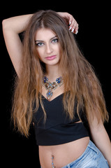 Woman with green eye contact lens , long hair and big necklace