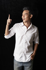 Asian man pointing finger up