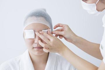 Woman wearing a gauze to eye