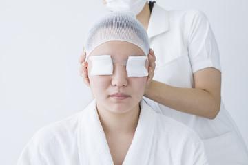 Women undergoing eye surgery
