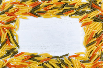 Raw Colorful Pasta Border on White Wood