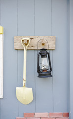 shovel and  lantern on the wall
