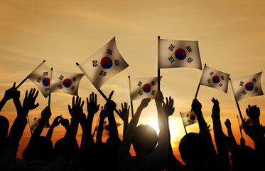 Group of People Waving South Korea Flags in Back Lit Concept