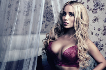 Romantic blonde woman in lingerie.