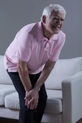 Pensioner having knee arthritis