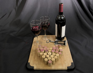 Wine with wine glasses and corks