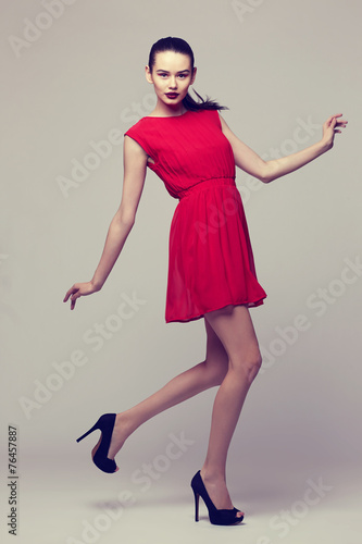 canvas print picture young elegant woman in red dress, fashion studio shot