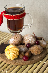 hot tea in a glass with cookies and chocolate