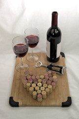 Wine with wine glasses, corkscrew and corks