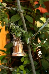 A silver bell on the Christmas tree.
