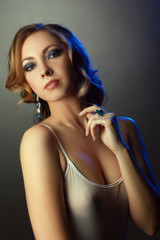 Portrait of seductive model posing in jewelry