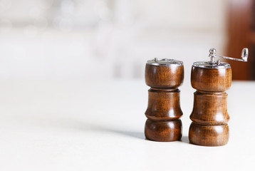 Kitchen tabletop with pepper shaker and pepper mill
