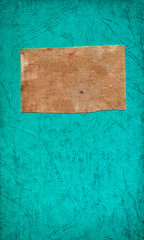 green paper background with a piece of canvas