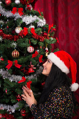 Cheerful christmas woman wishing
