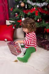Toddler boy opening Christmas gift