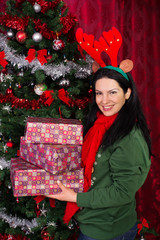 Happy woman holding Christmas gifts