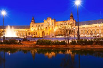 central building and reflection at  Plaza de Espana