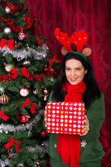 Happy woman with Christmas gift