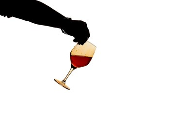 swill wine glass with man hand silhouette
