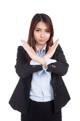 Young Asian businesswoman gesturing stop cross her arms