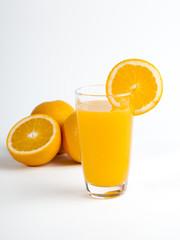 Sliced orange and a glass of orange juice