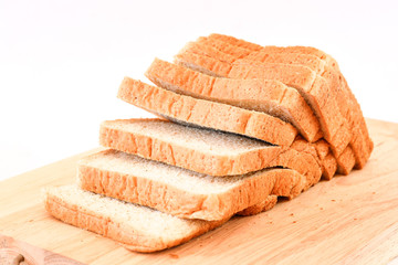 The cut loaf of bread on Wood block  on white Background