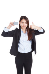 Young Asian businesswoman thumbs up show blank card