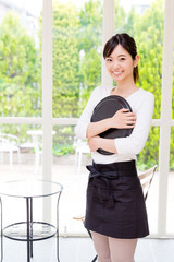 young asian waitress in the cafe