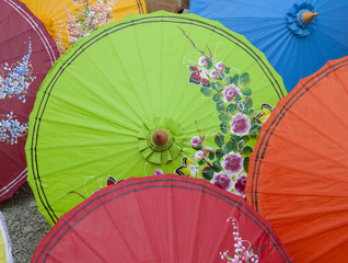 Colourful paper umbrella with flower pattern