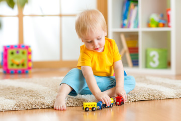 kid boy playing with toys indoor