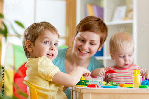 kids and mother playing colorful clay toy - 76462459
