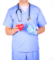 Doctor with heart and syringe, isolated on white