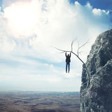 Businessman climbs a mountain