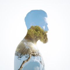 Double exposure of bearded guy and tree