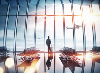 Businessman at airport near the window