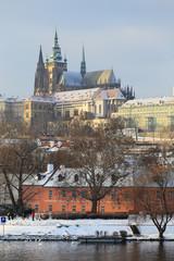 Snowy Prague gothic Castle abova River Vltava, Czech Republic
