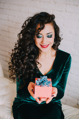 Happy beautiful woman opening present for Valentine's Day