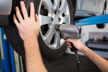 Mechanic adjusting the tire wheel