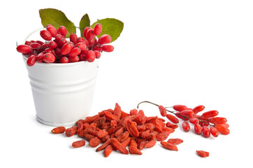 heap of goji berries near bowl of berberries