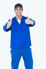 Happy mechanic holding spanner