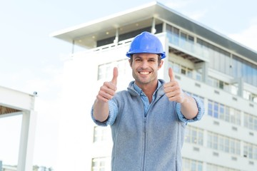 Confident male architect showing double thumbs up