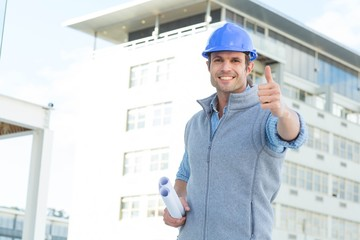 Happy male architect gesturing thumbs up