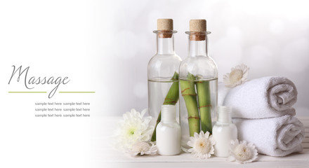 Spa setting on wooden table on light background