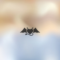 heart devil icon on blurred background