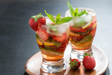 refreshing cocktail with strawberry and citrus in glasses