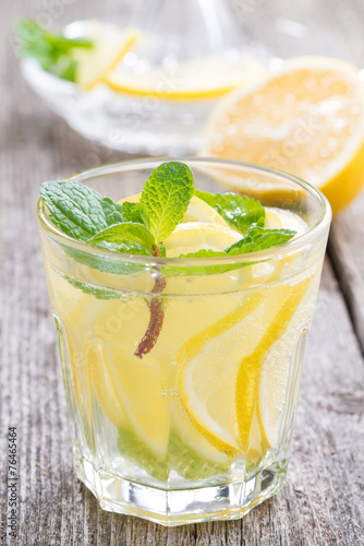 refreshing mint lemonade on a wooden table, close-up
