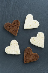 toasted rye and white bread in the form of heart on black