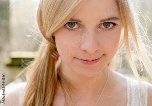Leinwanddruck Bild cute blonde woman outdoor