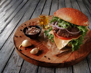 Rustic burgers with a cold drink on wooden