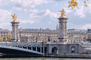 Paris, bridge Alexandre III, the Pegasus on a background cloudy